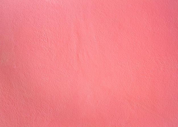 ピンク色によるセメントの壁のテクスチャ Premium写真