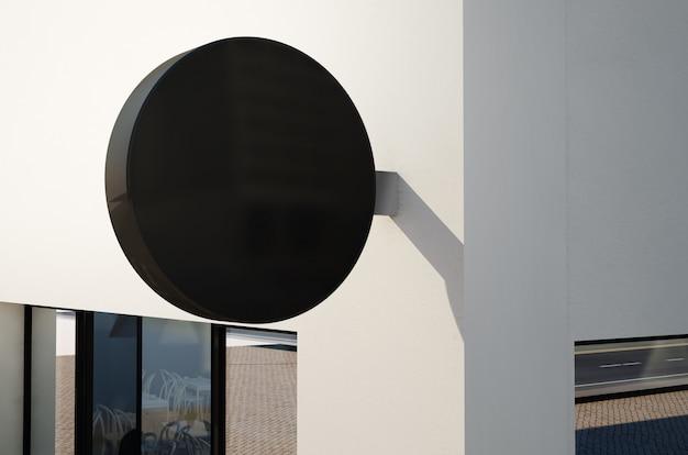 外壁の丸いサインのモックアップ Premium写真