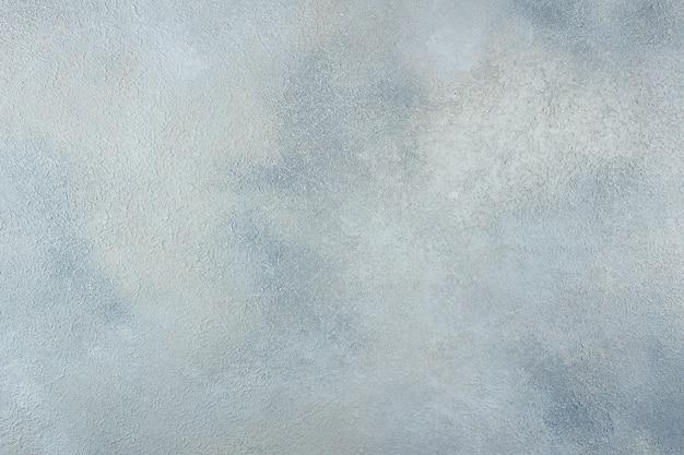 Абстрактная голубая светлая металлическая стена текстуры предпосылки конкретная или гипсолита ручной работы Premium Фотографии