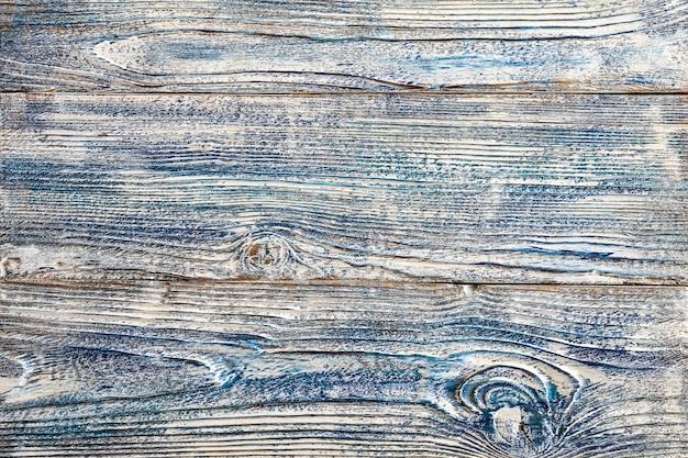 Белая синяя краска на старых деревянных досках деревянные доски перетасовывали несколько слоев Premium Фотографии