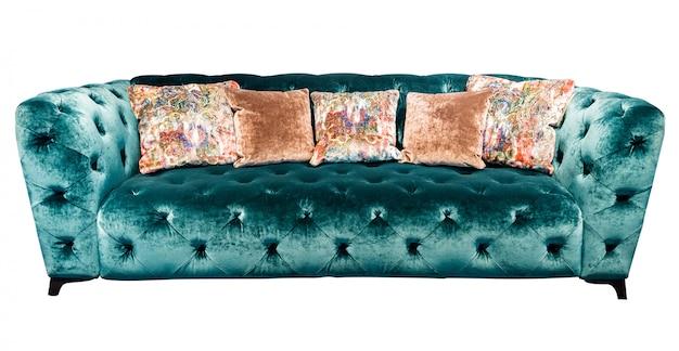枕とグリーンベロアソファー。分離されたクッションとソフトエメラルドソファ Premium写真