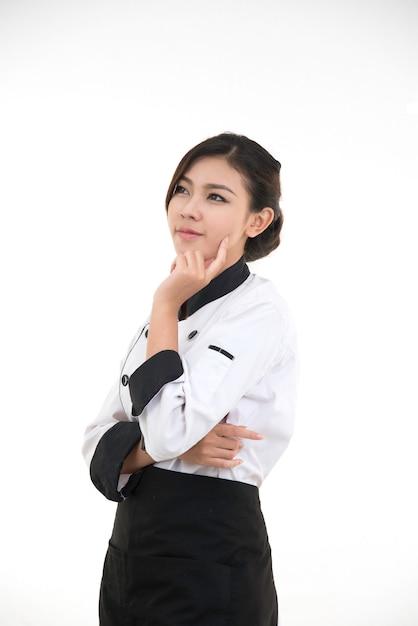 アジアの若いブルネットシェフの女性の肖像画 Premium写真