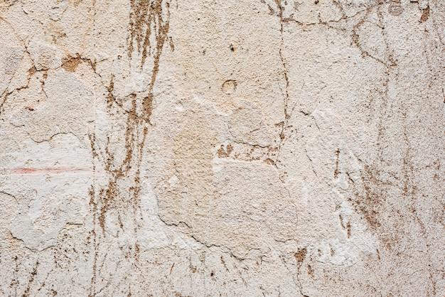 ひび割れや傷のあるコンクリートの壁のテクスチャ Premium写真