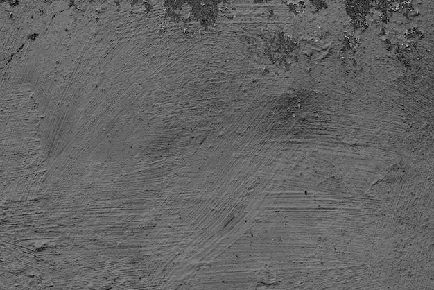 Бетонная стена с трещинами и царапинами Premium Фотографии