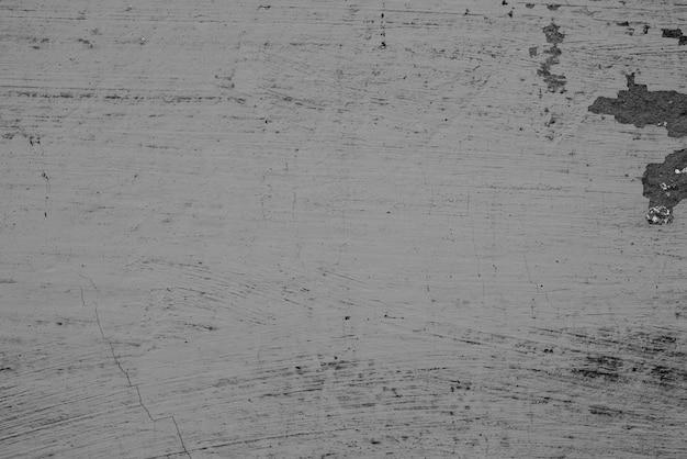 Текстура бетонной стены с трещинами и царапинами Premium Фотографии