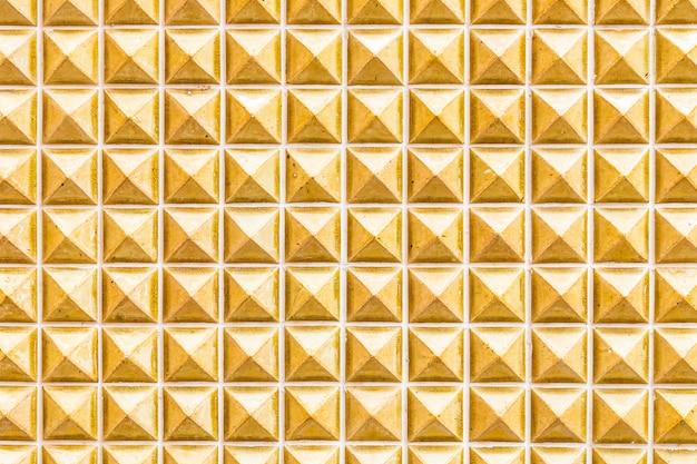 背景のための黄色の大理石のタイルの壁のテクスチャ 無料写真