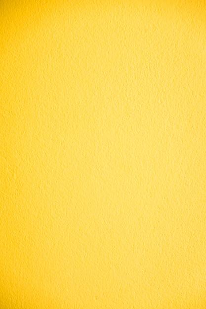 黄色のコンクリート壁のテクスチャ 無料写真