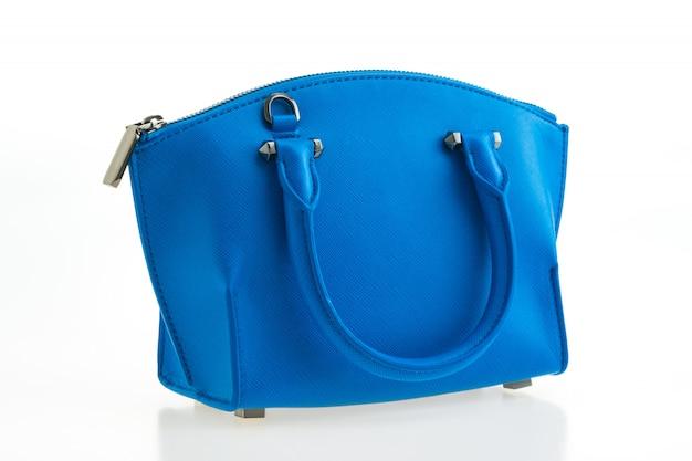 美しい優雅さと高級ファッションの女性と青いハンドバッグ 無料写真