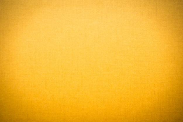 黄色のキャンバスのテクスチャ 無料写真