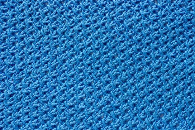 テクスチャ生地は青い糸で結ばれています。 Premium写真