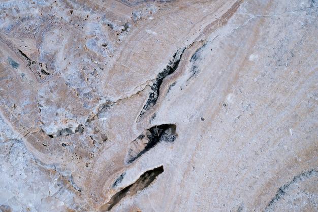 Ржавый коричневый камень поверхности текстуры фона крупным планом Premium Фотографии
