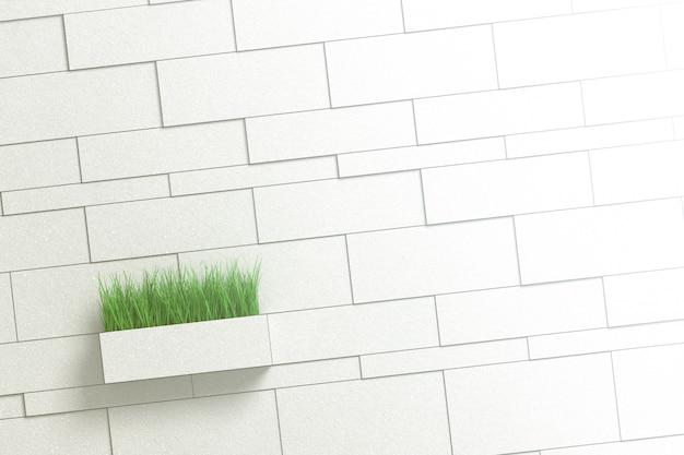 さまざまなレンガと草と長方形の鍋で灰色の壁の建築の背景。 Premium写真