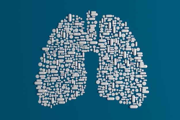 肺の形をした青に散在する多くの錠剤 Premium写真