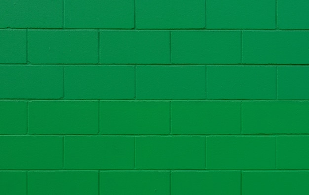 緑の塗られたレンガ壁のテクスチャと背景 Premium写真