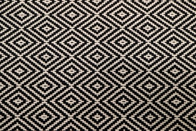 背景やバナーの黒と白のエスニックパターン生地の正面図 Premium写真