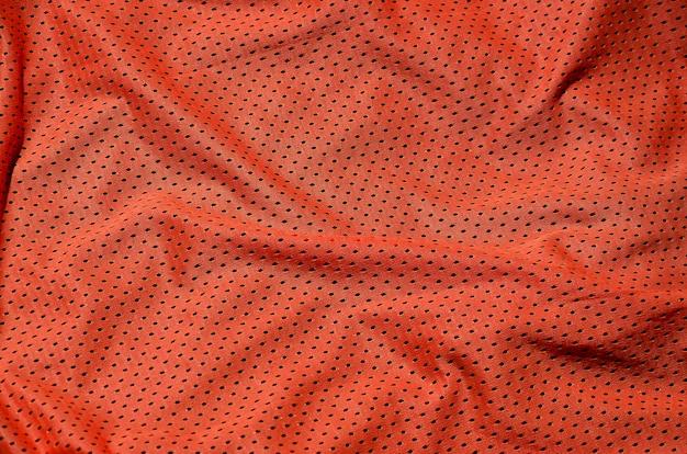 スポーツ服生地テクスチャ背景、赤い布繊維表面のトップビュー Premium写真