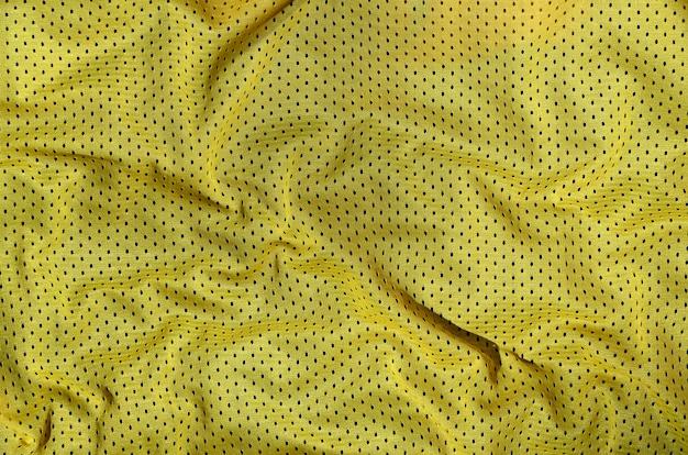 スポーツ服生地テクスチャ背景、黄色い布の繊維表面の平面図 Premium写真