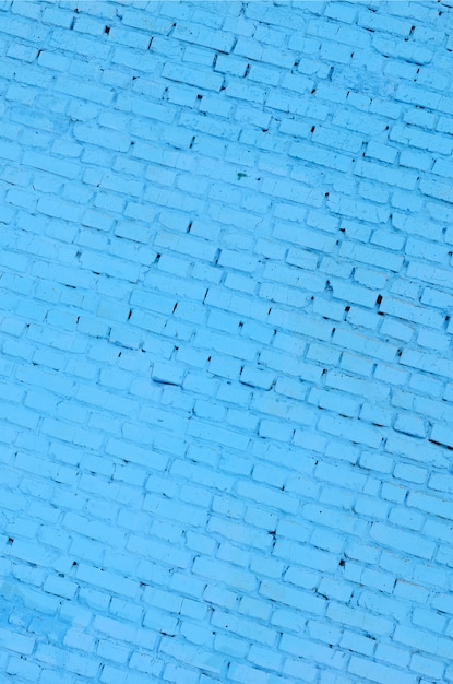 正方形のレンガブロック壁の背景色と質感。ブルー塗装 Premium写真