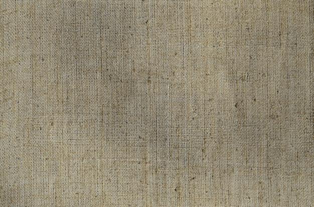 古くて粗い黄麻布で作られた灰色のキャンバスの質感。上面図 Premium写真