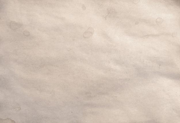 アンティークヴィンテージ崩壊しつつある紙原稿または羊皮紙の背景の古い空白部分 Premium写真