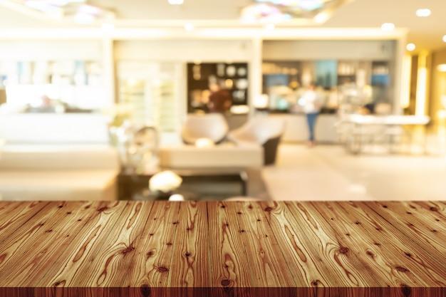 コーヒーショップ、カフェ、バーのぼやけた空の木製テーブルトップ Premium写真
