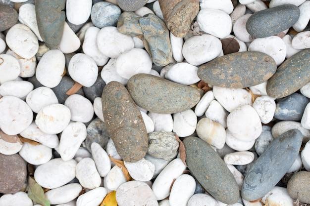 石の小石のテクスチャ背景 Premium写真