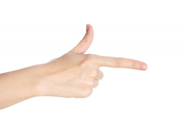 指差しジェスチャー。女性の手が白い表面に人差し指を示しています分離 Premium写真