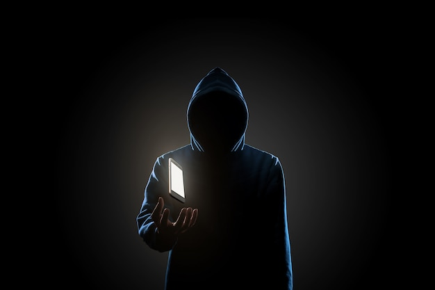 暗い背景の概念のハッカー Premium写真