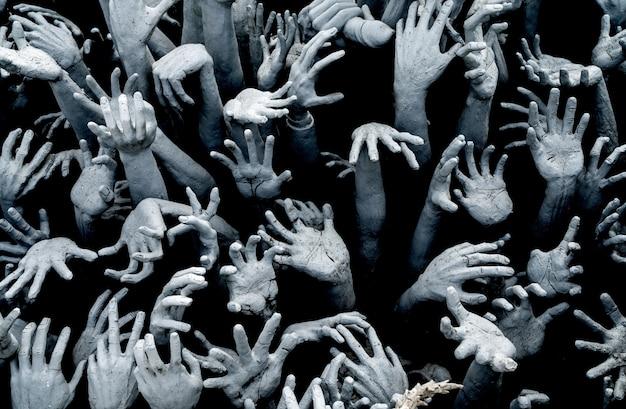 Руки из ада - ужасы фон зомби прорыв. Premium Фотографии