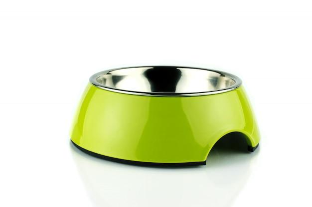 Зеленый питомец чаша. метакрилатный пищевой контейнер для собак или кошек. изолированный Premium Фотографии