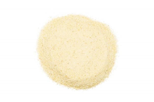 セモリナの束、クローズアップ、マクロ、トップビュー。料理に人気の小麦粉。 Premium写真