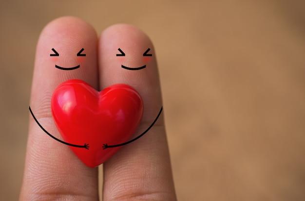 指の上の心。 Premium写真