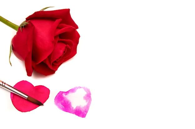 白地に赤いバラ Premium写真