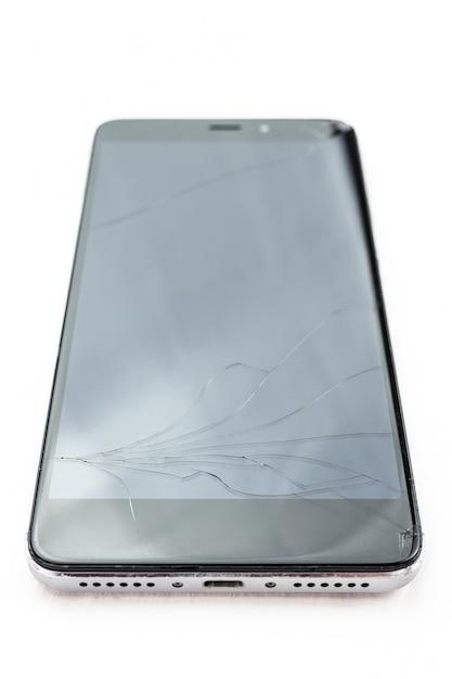 白い背景の上の壊れたスマートフォン Premium写真