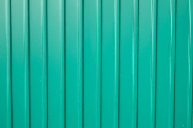 外側を仕上げるためのテクスチャの緑の金属サイディング Premium写真