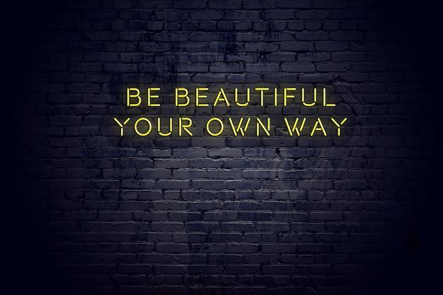 レンガの壁に対して肯定的な賢明な動機付けの引用とネオンサイン Premium写真