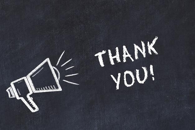 スピーカーと手書きの「ありがとう」とチョークボードスケッチ Premium写真
