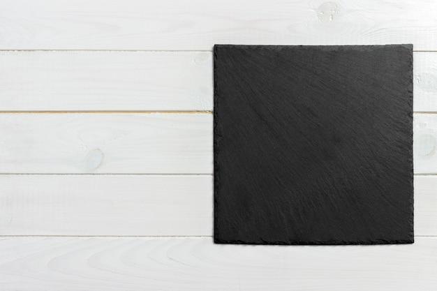 木製の背景、テキストを書くためのスペースにスレートボード Premium写真
