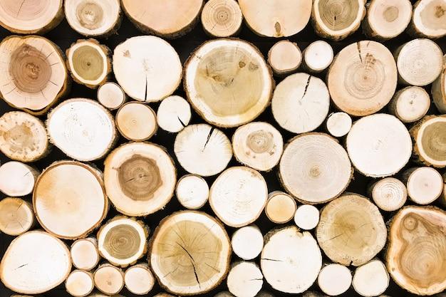 丸いチーク木の切り株の背景。木は、セクションテクスチャをカット Premium写真