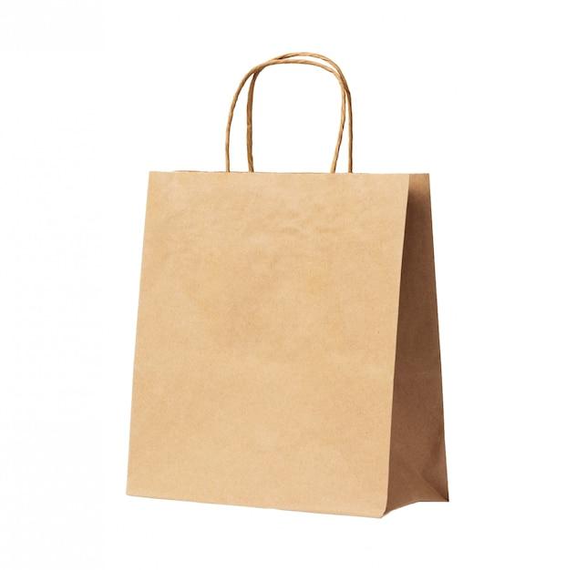 白い背景に分離された空白の茶色のリサイクル紙袋 Premium写真