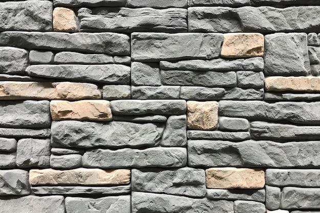 グレー色の石の壁。コンセプトインテリアデザインの背景と質感 Premium写真