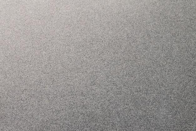粒状の金属のテクスチャ背景。ステンレス材 Premium写真