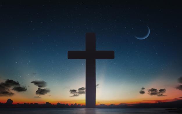 十字架のシルエットは、夕日と夜の空の月の背景でクロスします。 Premium写真