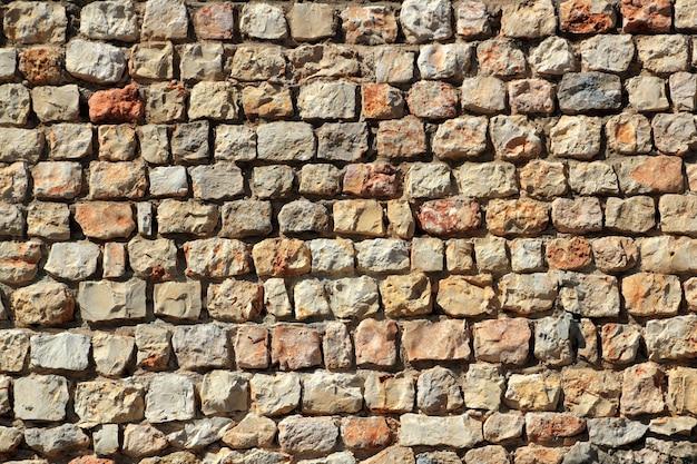 Каменная стена из коричневого кирпича испания традиция Premium Фотографии
