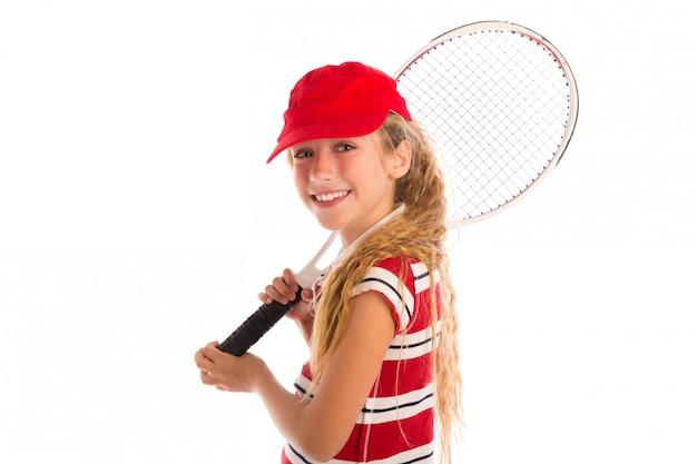 金髪のテニスガールパッドと赤い帽子笑顔 Premium写真