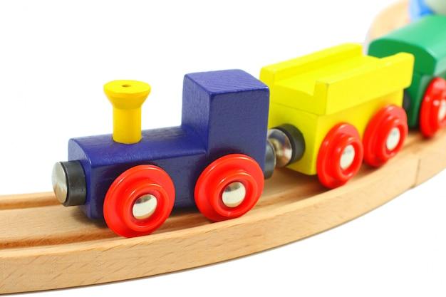 白で隔離されるレールに木製の鉄道グッズ Premium写真