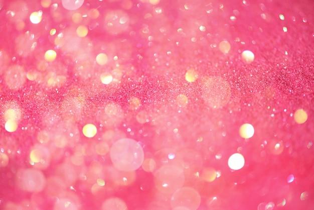 コピースペースとお祝いのピンクの背景。 Premium写真