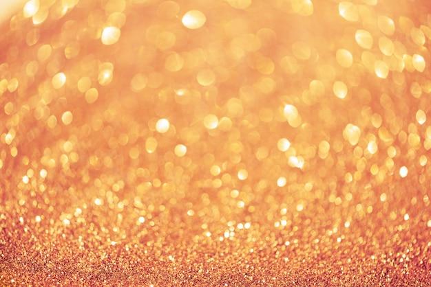 ピンクとゴールドの抽象的なボケ味が点灯します。 Premium写真