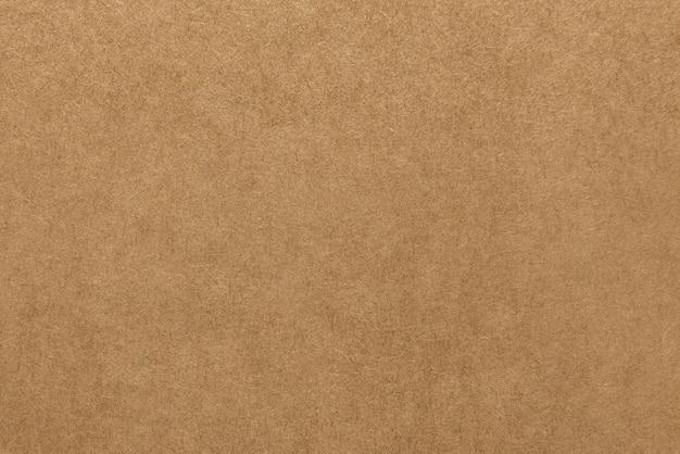 ライトブラウンクラフト紙の質感の背景 Premium写真