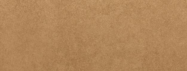 ライトブラウンクラフト紙の質感のバナーの背景 Premium写真